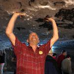 Jim holding up Turda Salt Mine ceiling