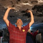 Jim holding up Turda Salt Mine ceiling